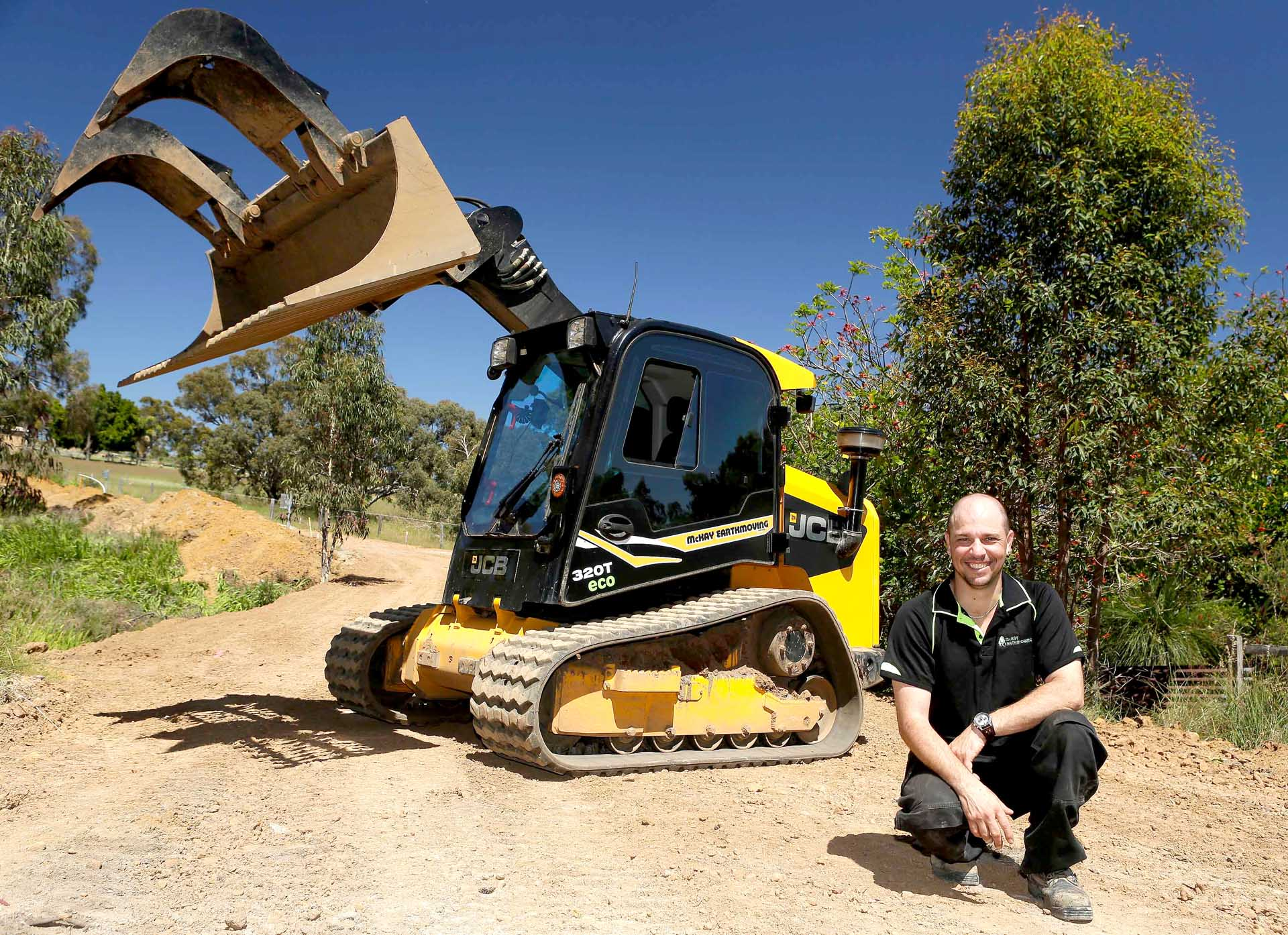 skid-steer-with-man