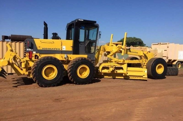 motor grader on truck and trailer